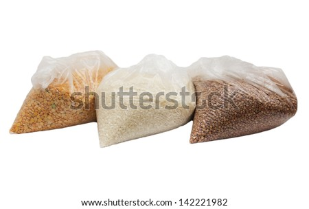 buckwheat, rice and peas in a plastic bag - stock photo