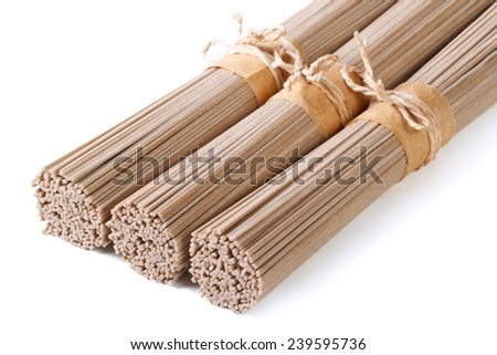 Buckwheat soba noodles in bunches isolated on white background. horizontal  - stock photo