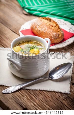 Buckwheat soup in the beautiful tureen. Shallow depth of field. - stock photo