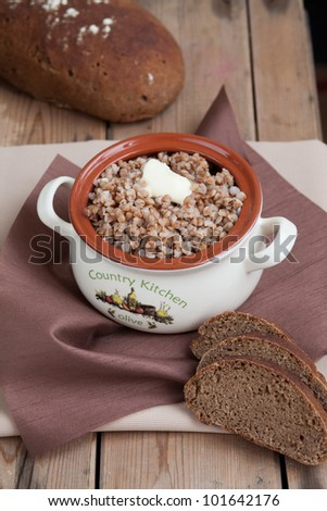 Buckwheat with butter in the pot - stock photo
