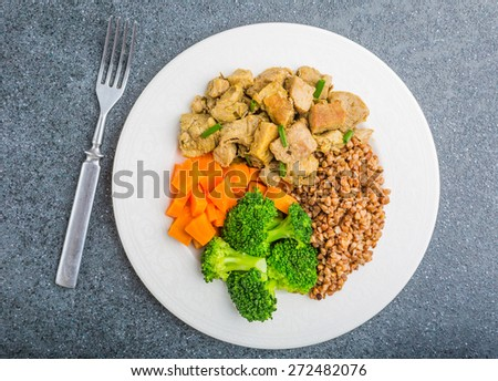 Buckwheat with meat and vegetables on table. studio shot - stock photo