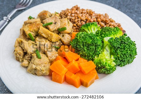 Buckwheat with meat and vegetables on table. studio shot