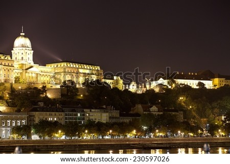 Buda Castle (Royal Palace) by the Danube river illuminated at night in Budapest, Hungary. - stock photo
