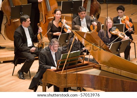 BUDAPEST - APRIL 27: Members of the Anima Eterna Philharmonic Orchestra perform on stage at MUPA, Conductor: Jos van Immerseel on April 27, 2010 in Budapest, Hungary.