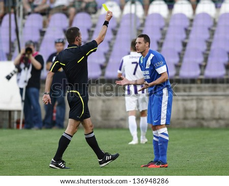 BUDAPEST - APRIL 30: Yellow card for Sandor Hidvegi of MTK during Ujpest vs. MTK OTP Bank League football match at Szusza Stadium on April 30, 2013 in Budapest, Hungary.