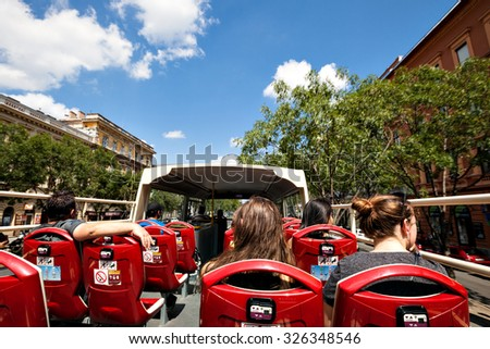 BUDAPEST - AUG 3: Budapest Sightseeing bus on Aug 3, 2015, Budapest, Hungary. Open-top tour bus with audio guide, great way see the Budapest's major sights in short time. - stock photo
