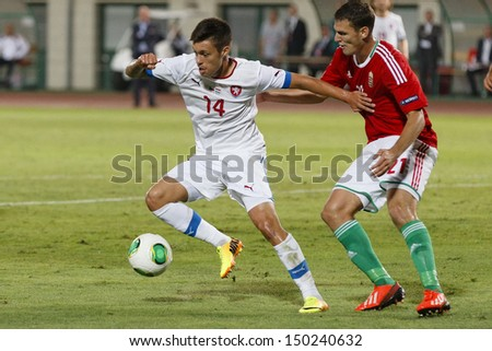 BUDAPEST - AUGUST 14: From Hungarian Zsolt Korcsmar (R) covers the ball Czech Vaclav Kadlec during Hungary vs Czech Republic football match at Puskas Stadium on August 14, 2013 in Budapest, Hungary - stock photo