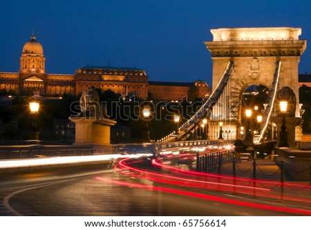 Budapest bridge illuminated at night.