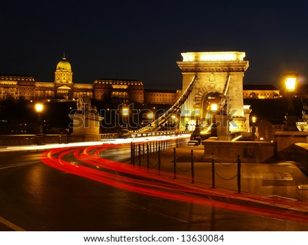 Budapest Chain Bridge at night with cars.