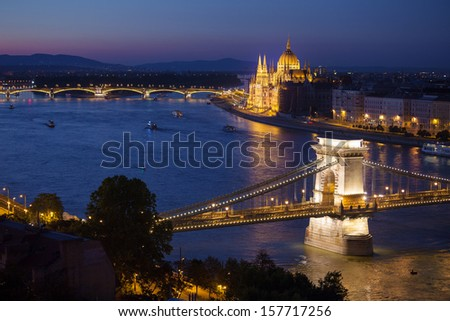Budapest cityscape sunset with Chain Bridge in front over Danube river and with Parliament Building in the background.