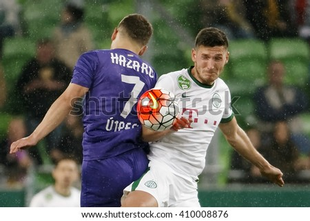 BUDAPEST, HUNGARY - APRIL 23, 2016: Adam Pinter of FTC(r) battles for the ball in the air with Kylian Hazard of Ujpest during Ferencvaros - Ujpest OTP Bank League football match at Groupama Arena.  - stock photo