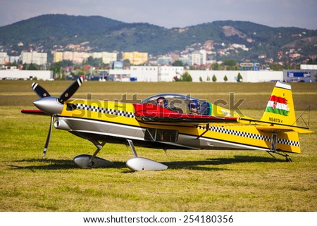 BUDAPEST, HUNGARY - APRIL 30:  Aerobatics planes parked at the tarmac at Budaors airport These planes are designed for aerobatic flights.on April 30, 2014 near Budapest, Hungary.  - stock photo