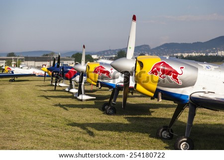 BUDAPEST, HUNGARY - APRIL 30:  Aerobatics planes parked at the tarmac at Budaors airport These planes are designed for aerobatic flights on April 30, 2014 near Budapest, Hungary.  - stock photo