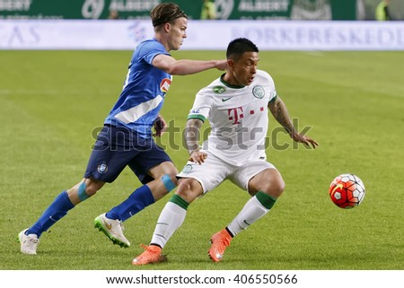 BUDAPEST, HUNGARY - APRIL 16, 2016: Cristian Ramirez of Ferencvaros (r) duels for the ball with Daniel Gera of MTK during Ferencvaros - MTK Budapest OTP Bank League football match at Groupama Arena.  - stock photo