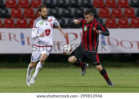 BUDAPEST, HUNGARY - APRIL 2, 2016: Duel between Endre Botka of Honved (r) and Andras Fejes of Videoton during Budapest Honved - Videoton OTP Bank League football match at Bozsik Stadium. - stock photo