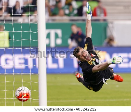BUDAPEST, HUNGARY - APRIL 13, 2016: Goalkeeper Bozidar Radosevic of DVSC cannot save a free kick shot during Ferencvaros - DVSC Hungarian Cup semi-final football match at Groupama Arena.