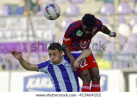 BUDAPEST, HUNGARY - APRIL 30, 2016: Kylian Hazard of Ujpest (l) battles for the ball in the air with Stopira of Videoton during Ujpest - Videoton OTP Bank League football match at Szusza Stadium. - stock photo