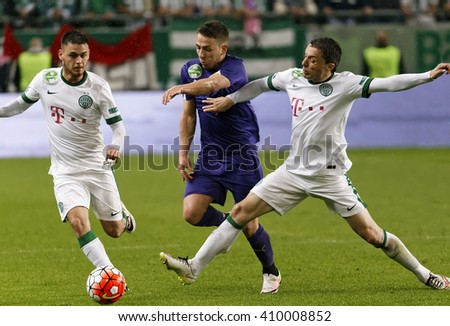 BUDAPEST, HUNGARY - APRIL 23, 2016: Kylian Hazard of Ujpest tries to break out between Andras Rado (l) and Vladan Cukic (r) of FTC during FTC - Ujpest OTP Bank League football match at Groupama Arena. - stock photo