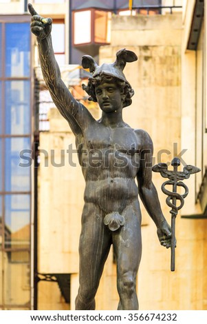 BUDAPEST HUNGARY APRIL 29 2014: Statue of Mercury by David Pride  in the hart of Budapest Vaci St. This statue is well exposed to tourists and art lover however one of the lesser known art.  - stock photo