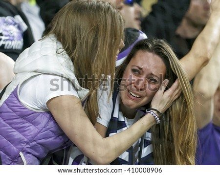 BUDAPEST, HUNGARY - APRIL 23, 2016: Supporter of Ujpest weeps for joy after her team's first score during Ferencvaros - Ujpest OTP Bank League football match at Groupama Arena. - stock photo