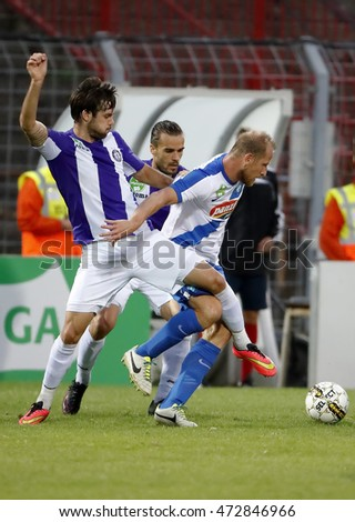 BUDAPEST, HUNGARY - AUGUST 21, 2016: Kalnoki Kis (L) of Ujpest fights for the ball with Torghelle (R) of MTK during the OTP Bank Liga match between Ujpest FC and MTK Budapest at Illovszky Stadium.