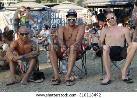 BUDAPEST, HUNGARY - AUGUST 13, 2015: Summer music festival everyday life. Visitors of Sziget music festival enjoy hot weather. Sziget is one of biggest festivals in Europe.