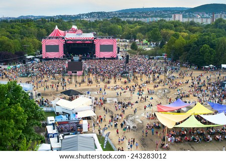 BUDAPEST, HUNGARY - AUGUST 13, 2014: Visitors of Sziget music festival in front of the main stage. Sziget is one of biggest festivals in Europe  - stock photo
