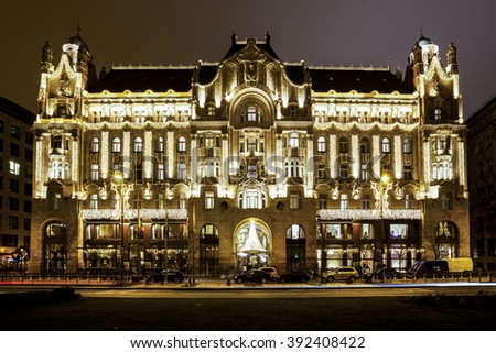 BUDAPEST, HUNGARY - DEC 19 2015: Gresham Palace at night with Christmas lights at the in Budapest, Hungary. This traditional Christmas fair attracts abut 700,000 visitors each year. - stock photo
