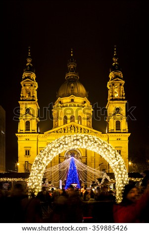 BUDAPEST, HUNGARY - DEC 19 2015: Tourists enjoy the Christmas lights at the St Steven Basilica in Budapest, Hungary. This traditional Christmas fair attracts abut 700,000 visitors each year.