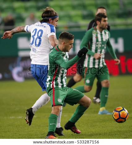 BUDAPEST, HUNGARY - DECEMBER 10, 2016: Andras Rado (R) of Ferencvarosi TC competes for the ball with Adam Vass #38 of MTK Budapest during Ferencvaros v MTK OTP Bank Liga match at Groupama Arena
