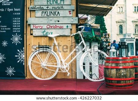 BUDAPEST, HUNGARY - DECEMBER, 28: Decorative bicycle on stand at Christmas market near Saint Stephan's Basilica in Budapest, Hungary. Winter of 2015 - stock photo