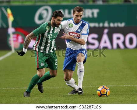 BUDAPEST, HUNGARY - DECEMBER 10, 2016: Marco Djuricin (L) of Ferencvarosi TC fights for the ball with Akos Baki (R) of MTK Budapest during Ferencvaros v MTK OTP Bank Liga match at Groupama Arena