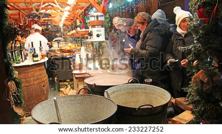 BUDAPEST, HUNGARY - DECEMBER 31, 2012: People buy mulled wine at traditional Christmas market on Vorosmarty Square - stock photo