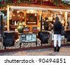 BUDAPEST, HUNGARY - DECEMBER 9: Tourists enjoy the Christmas market in front of the Saint Stephen's Basilica on December 9, 2011 in Budapest, Hungary. - stock photo