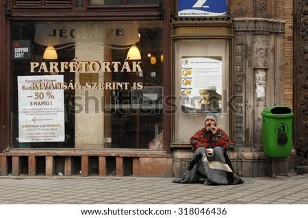 BUDAPEST, HUNGARY - FEBRUARY 23, 2012: A homeless man panhandles on the streets of Budapest, Hungary, February 23, 2012. - stock photo