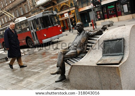 BUDAPEST, HUNGARY - FEBRUARY 24, 2012: A pedestrian walks past bronze statue in Theatre District, nicknamed Budapest's Broadway, in Budapest, Hungary, February 24, 2012. - stock photo