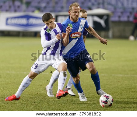 BUDAPEST, HUNGARY - FEBRUARY 20, 2016: Duel between Enis Bardhi of Ujpest (l) and Sandor Torghelle of MTK during Ujpest - MTK Budapest OTP Bank League football match at Szusza Stadium.