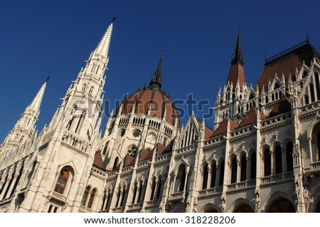 BUDAPEST, HUNGARY - FEBRUARY 20, 2012: Pictured is a Hungarian Parliament Building on a sunny winter day in Budapest, Hungary, February 20, 2012. - stock photo