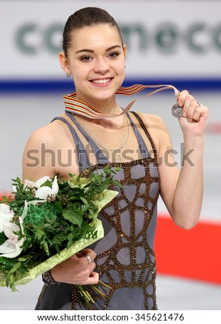 BUDAPEST, HUNGARY - JANUARY 17, 2014: Adelina SOTNIKOVA of Russia poses at the victory ceremony at ISU European Figure Skating Championship in Syma Hall Arena. - stock photo