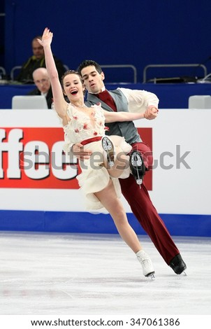 BUDAPEST, HUNGARY - JANUARY 16, 2014: Anna CAPPELLINI / Luca LANOTTE of Italy perform free dance at ISU European Figure Skating Championship in Syma Hall Arena. - stock photo