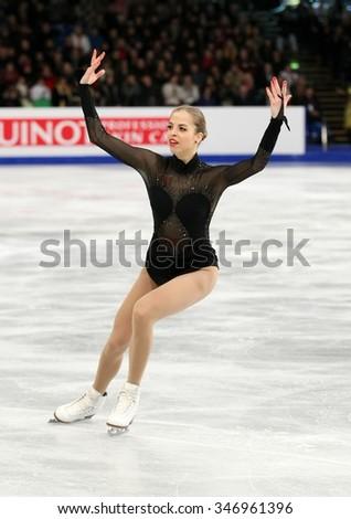 BUDAPEST, HUNGARY - JANUARY 17, 2014: Carolina KOSTNER of Italy performs free program at ISU European Figure Skating Championship in Syma Hall Arena. - stock photo