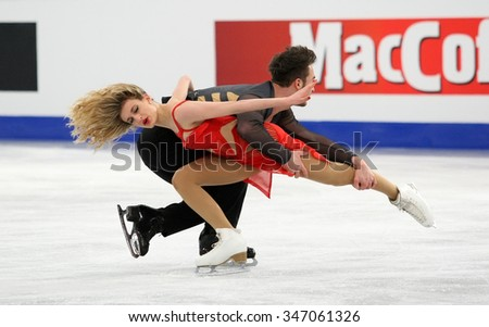 BUDAPEST, HUNGARY - JANUARY 16, 2014: Gabriella PAPADAKIS / Guillaume CIZERON of France perform free dance at ISU European Figure Skating Championship in Syma Hall Arena. - stock photo