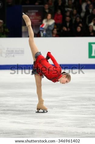 BUDAPEST, HUNGARY - JANUARY 17, 2014: Julia LIPNITSKAIA of Russia performs free program at ISU European Figure Skating Championship in Syma Hall Arena. - stock photo