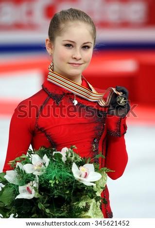 BUDAPEST, HUNGARY - JANUARY 17, 2014: Julia LIPNITSKAIA of Russia poses at the victory ceremony at ISU European Figure Skating Championship in Syma Hall Arena. - stock photo