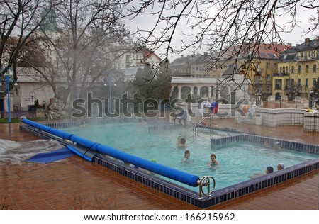 BUDAPEST, HUNGARY - JANUARY 4: People have a thermal bath in the Gellert spa on January 4,2012 in Budapest. Gellert Medicinal Bath was opened in 1918 and now is one of the most famous bath in Budapest - stock photo