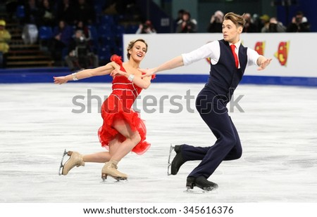 BUDAPEST, HUNGARY - JANUARY 15, 2014: Pernelle CARRON / Lloyd JONES of France perform short dance at ISU European Figure Skating Championship in Syma Hall Arena. - stock photo