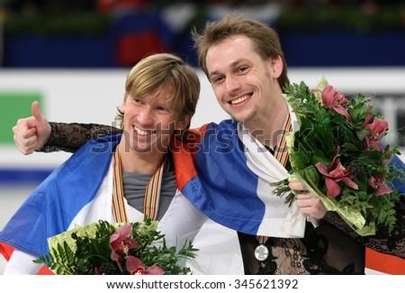 BUDAPEST, HUNGARY - JANUARY 18, 2014:Sergei VORONOV and Konstantin MENSHOV pose at the victory ceremony at ISU European Figure Skating Championship in Syma Hall Arena. - stock photo