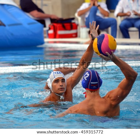 Budapest, Hungary - Jul 14, 2014. Francesco DI FULVIO (ITA, 2) defends against Roman SHEPELEV (RUS, 12).The Waterpolo European Championship was held in Alfred Hajos Swimming Centre in 2014.