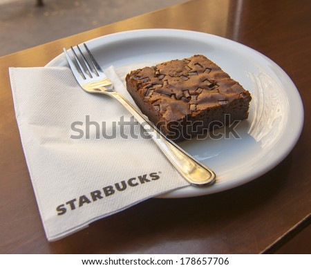 BUDAPEST, HUNGARY - JULY 8, 2013: Brownie cake in Starbucks coffeehouse in Budapest, Hungary Starbucks is the world's largest coffeehouse company. - stock photo