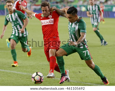 BUDAPEST, HUNGARY - JULY 30, 2016: Cristian Ramirez #77 of FTC duels for the ball with Diego Vela (R) of DVTK during the OTP Bank Liga match between Ferencvarosi TC and DVTK at Groupama Arena.
